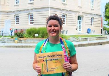 "Tour Guide Kayla Southern is pictured above with a copy of the ""Historic Maury County Coloring Book"" she wrote and illustrated in 2017. Kayla's day job is as a Registered Dental Hygienist. History is one of her many hobbies."